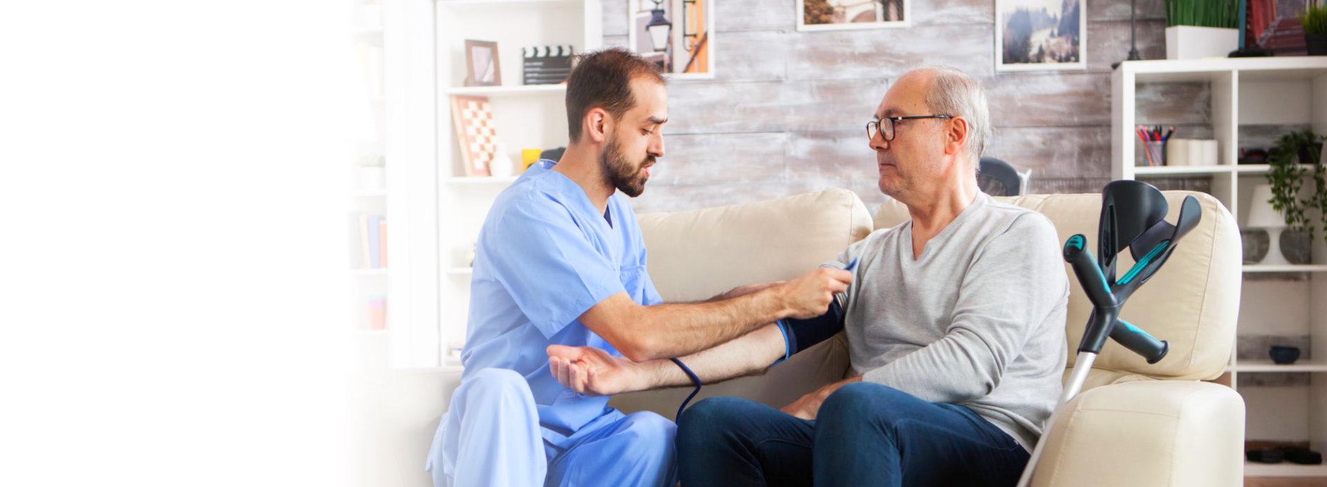 caregiver serving senior man